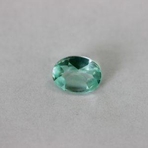 Синтетичен шпинел,форма овал, р-р 9 х 7, цвят зелен шпинел